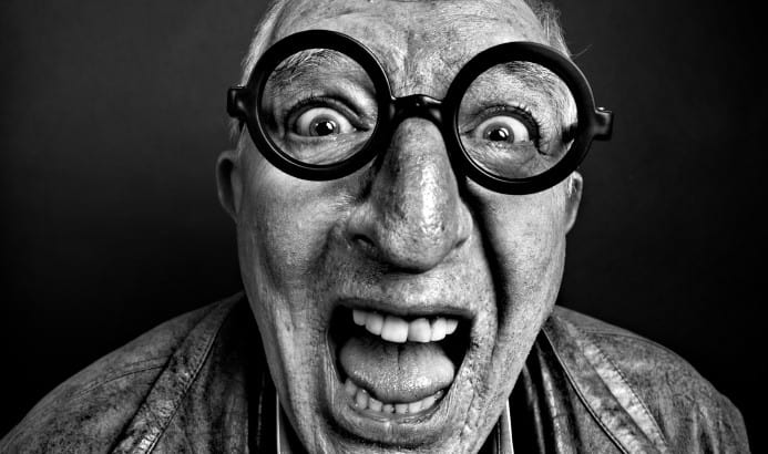 Crazy man with glasses.